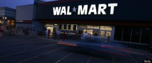 ST. LOUIS COUNTY, MO - MAY 11:  Night settles in on a 24-hour Wal-Mart May 11, 2005 in St. Louis County, Missouri. Wal-Mart, America's largest retailer and the largest company in the world based on revenue, has evolved into a giant economic force for the U.S. economy. With growth, the company continues to weather criticism of low wages, anti-union policies as well as accusations that it has homogenized America's retail economy and driven traditional stores and shops out of business.  (Photo by Chris Hondros/Getty Images)